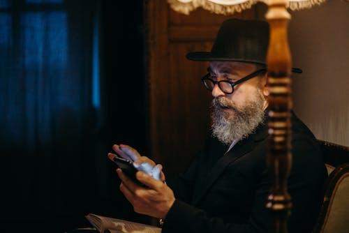 Photo Of Man Using Smartphone