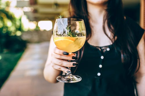 Photo Of Person Holding Wine Glass