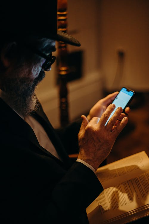 Photo Of An Old Man Using Mobile Phone