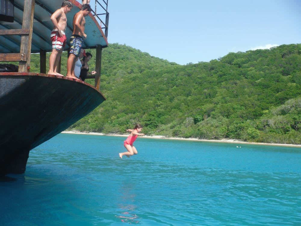 Free stock photo of jumping off the Willy T in the BVI