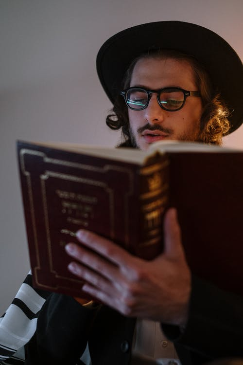 Young Man Reading a Book