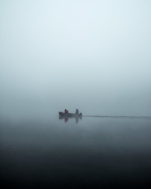 People In A Boat on A Foggy Day
