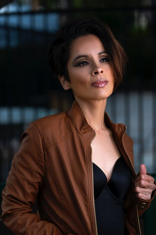 Woman in Brown Leather Jacket