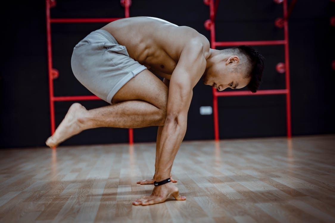 Photo Of Man Doing Handstand