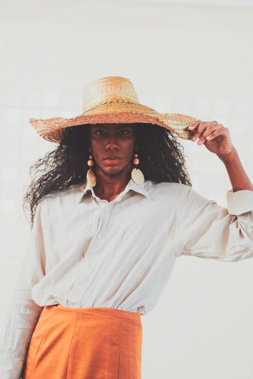 Photo Of Woman Wearing Straw Hat