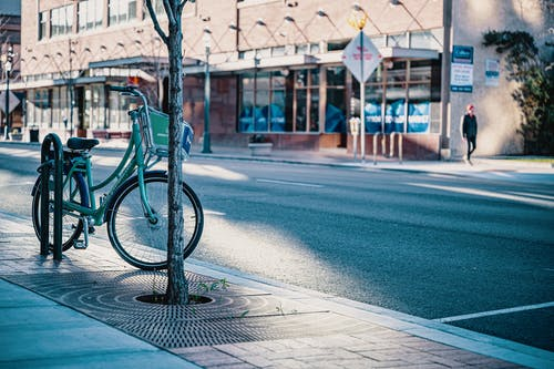 Photo Of Bicycle On Side Street