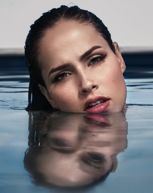 Photo Of Woman's Head Above Water