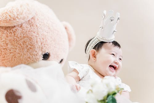 Photo Of Baby Beside Stuffed Toy