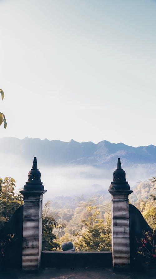 Dramatic view of landmark on mountain