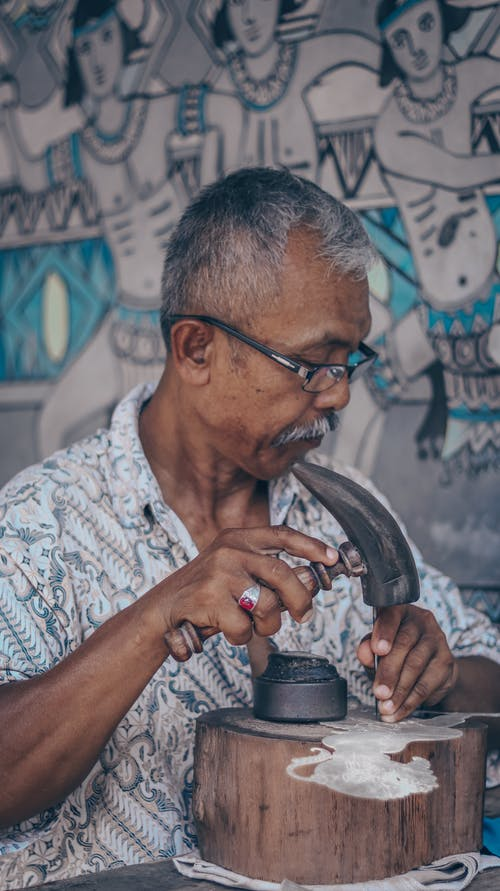 Concentrated senior artist working in studio