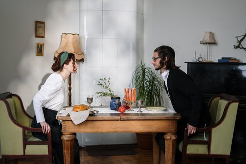 Couple Sitting at Table