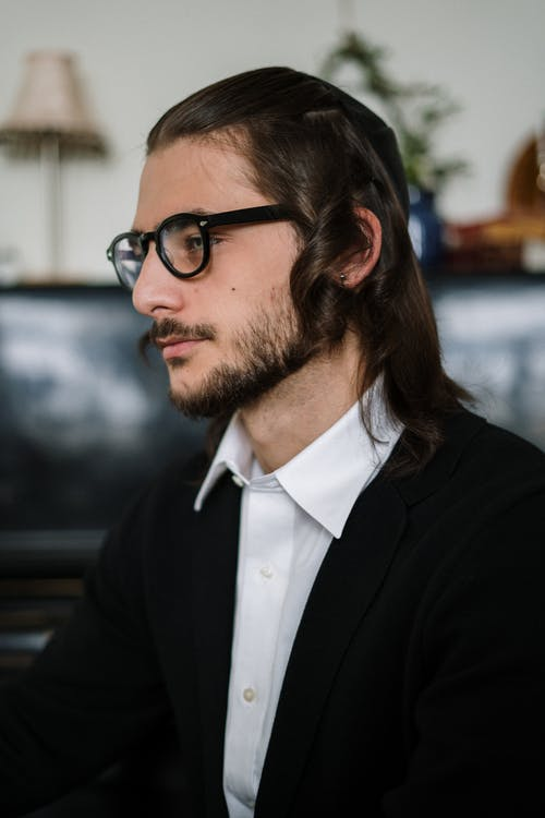 Bearded Man with Long Hair and Glasses