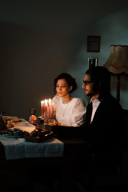 Jewish Couple With a Menorah