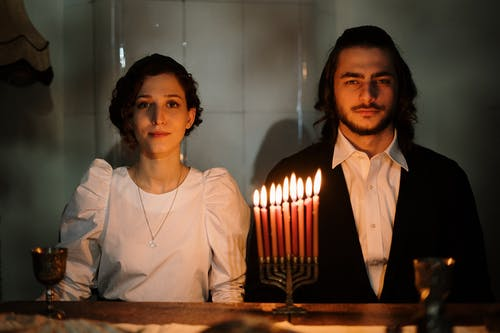 Jewish Couple With a Menorah