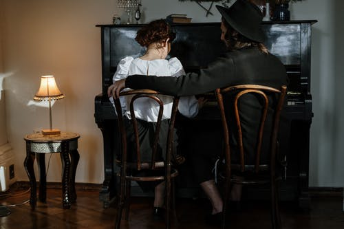 Couple in Front of a Piano