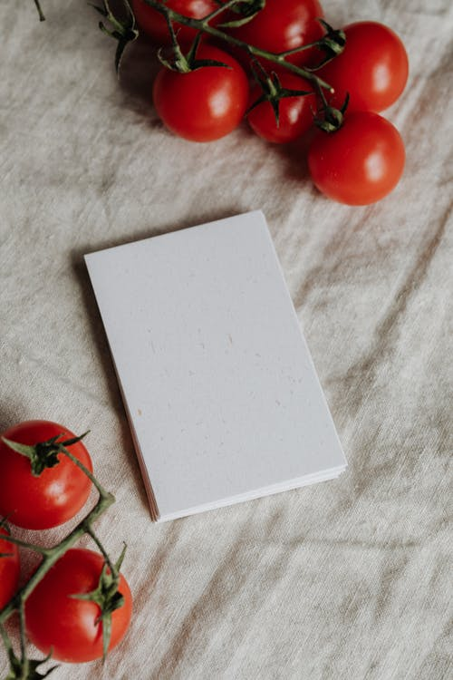 Photo Of Clear Papers Near Tomatoes