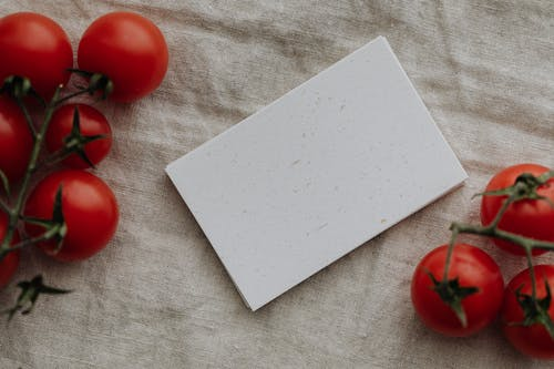 Photo Of Tomatoes Near Blank Papers