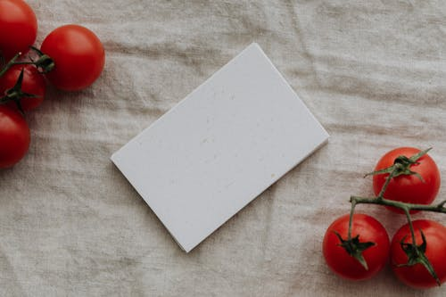 Photo Of Blank Papers Near Tomatoes