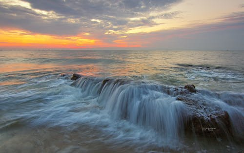 Time-lapse Photo of Body of Water at Golden Hour