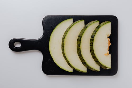 Photo Of Sliced Melon On Chopping Board