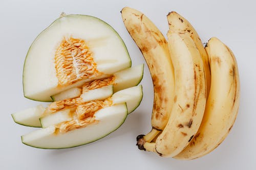 Photo Of Banana Beside Sliced Melon