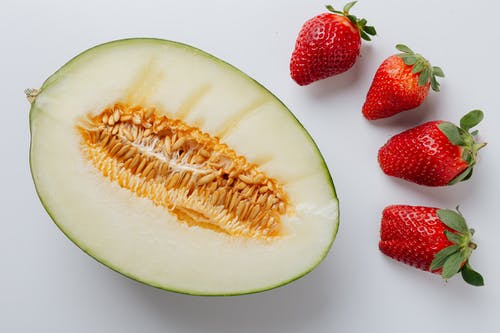 Photo Of Melon Near Strawberries