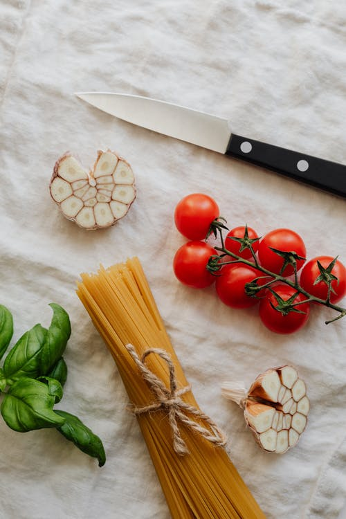 Photo Of Pasta Beside Cherry Tomatoes