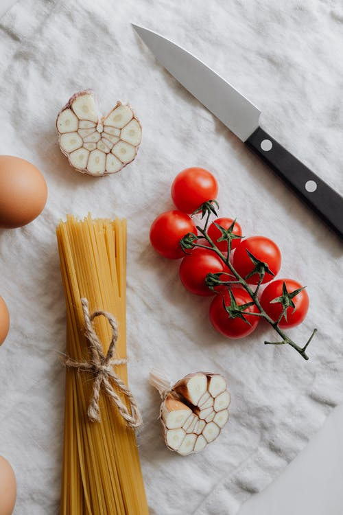 Photo Of Knife Beside Cherry Tomatoes