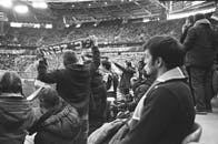 Spectators watching match on large stadium