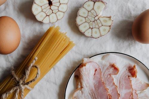 Photo Of Sliced Garlic Beside Pasta