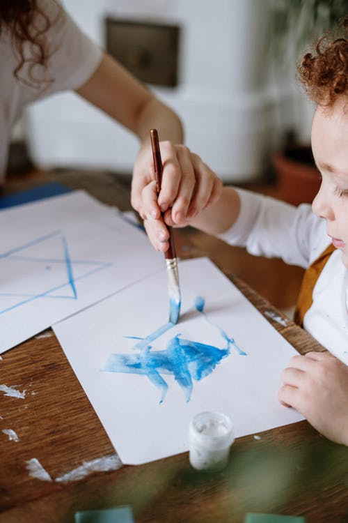 Small Boy Painting