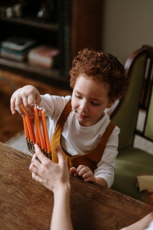 Child Holding Candles