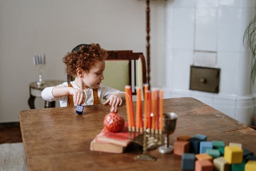 Child Playing With a Dreidel