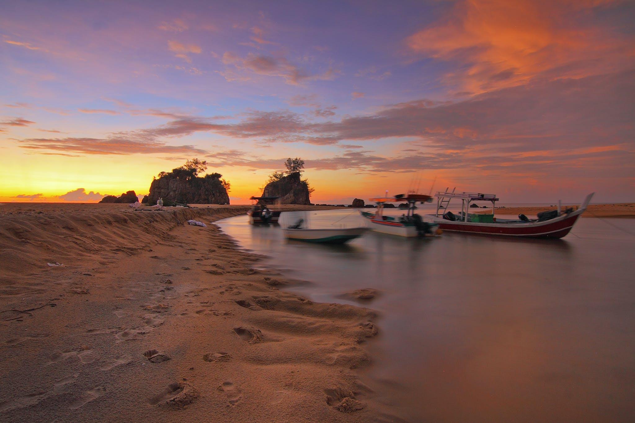 White Boat Docking on Seashore during Sunset