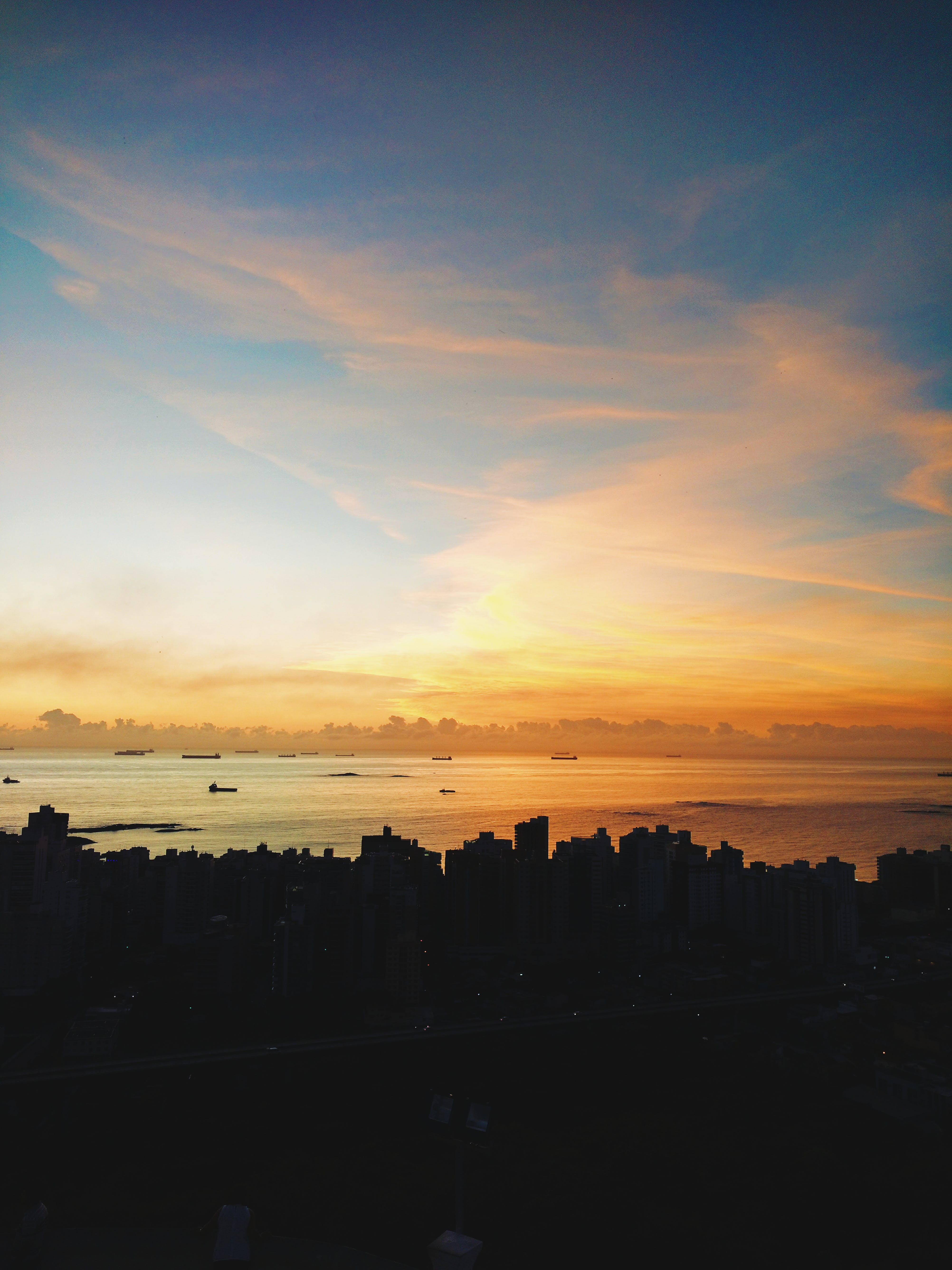 Free stock photo of sea, city, sky, clouds