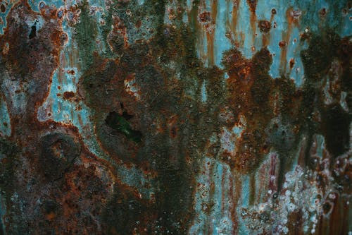 Abstract background of weathered metal rusty water eroded surface with traces of water