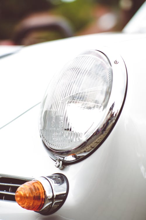 Silver Car Headlight in Close Up Photography