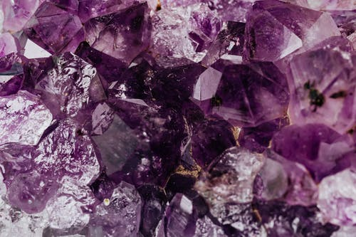 Set of shiny transparent amethysts grown together