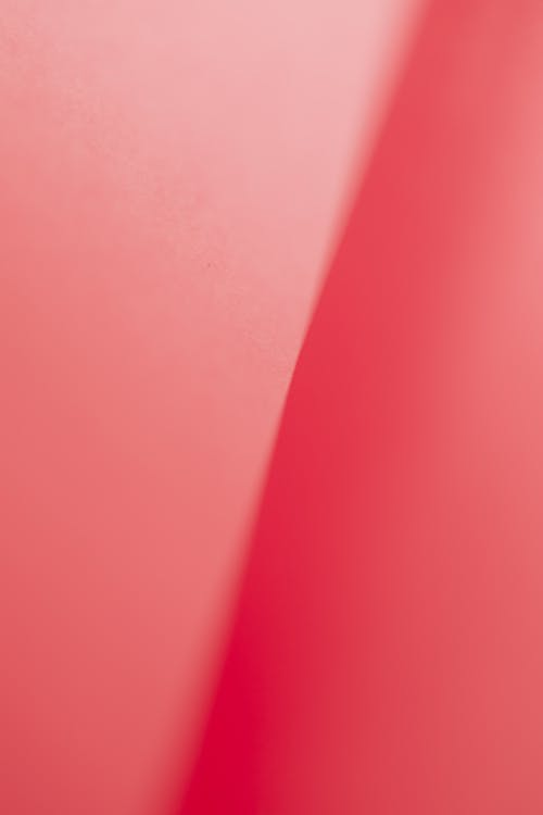 Pink textured background with gradient line in middle of cardboard