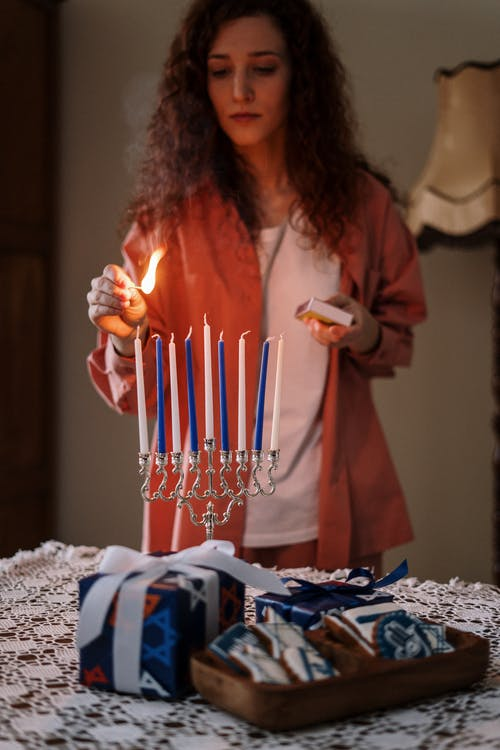 Woman Lighting up Candles
