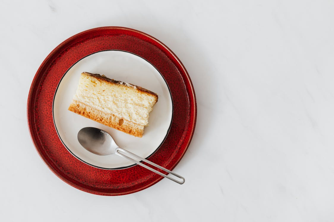 Piece of delicious cheesecake on plate