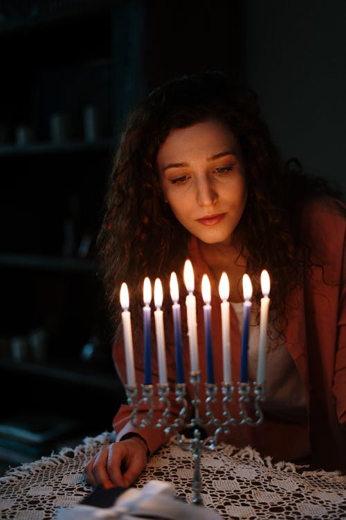 Jewish Woman With a Menorah