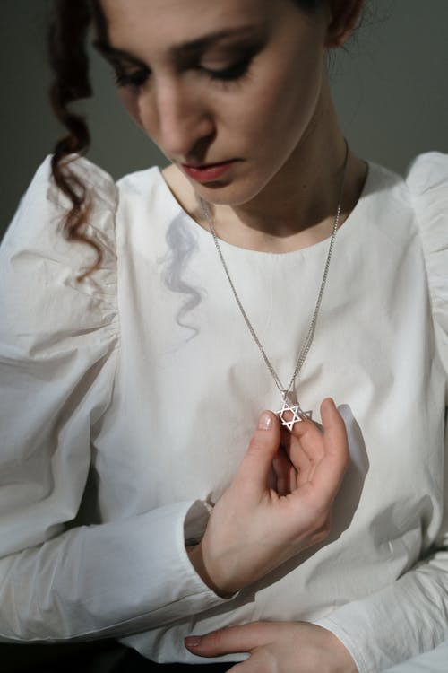 Woman Holding a Star of David