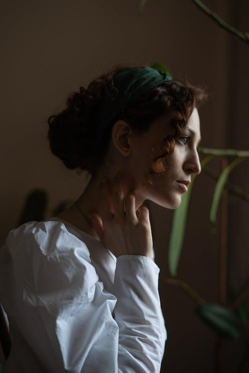 Woman in Dim Light