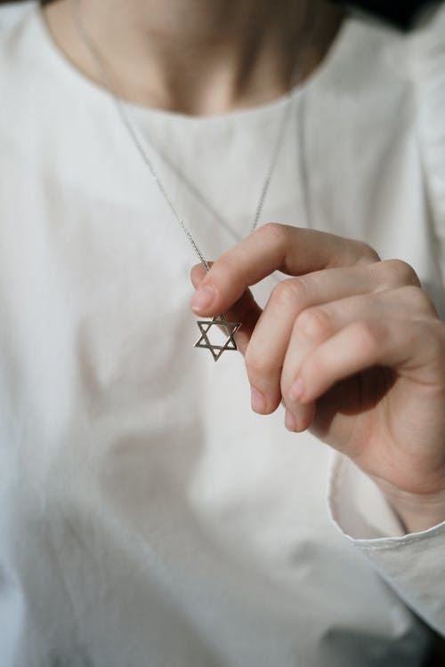 Person Holding a Star of David