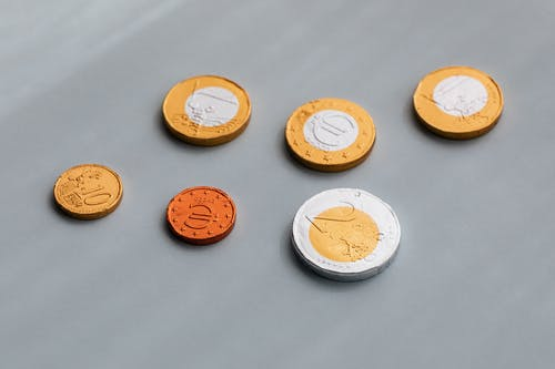 Set of diverse coins on gray table