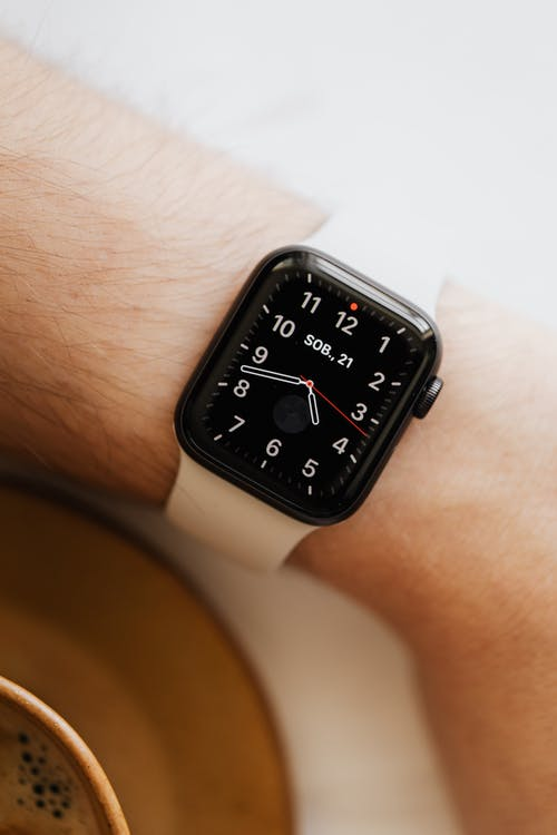 Crop person with smart watch on wrist