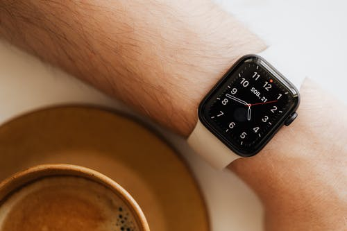 Faceless man wearing smart watch and drink coffee
