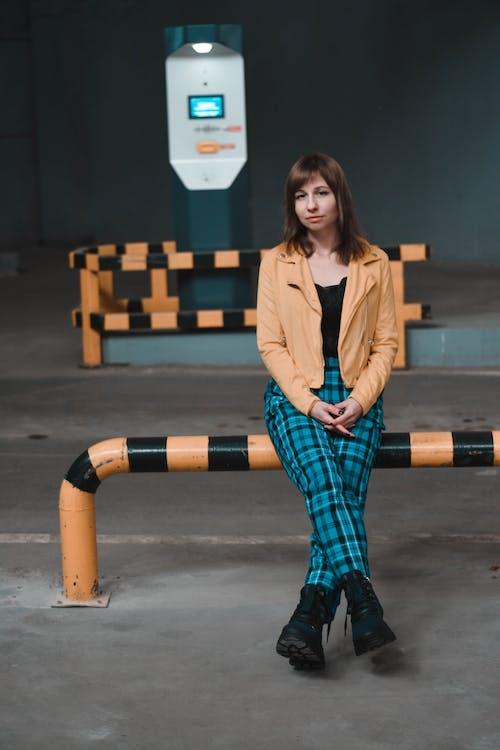 Stylish relaxed female on underground parking