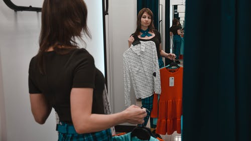 Female customer choosing clothes in store